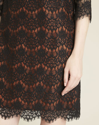 Black lace dress with orange underlay black.