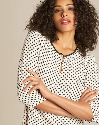 Gastric pastel blouse with black polka dots powder.