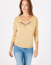 Phoenix shiny golden sweater with open back gold.