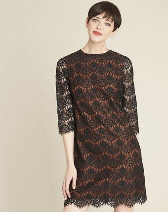 Kleid aus schwarzer spitze auf orangefarbenem hintergrund schwarz.
