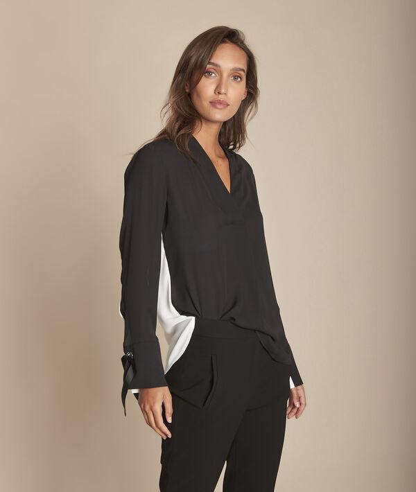 Tweekleurige zwarte blouse met ringetjes aan de polsen Marinette PhotoZ | 1-2-3