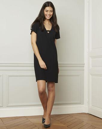 Zwarte jurk met sieraad noel noir.